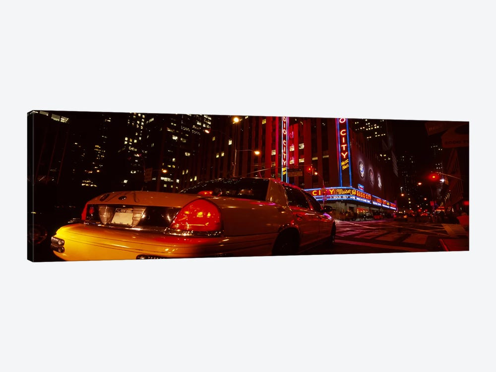 Car on a road, Radio City Music Hall, Rockefeller Center, Manhattan, New York City, New York State, USA by Panoramic Images 1-piece Art Print