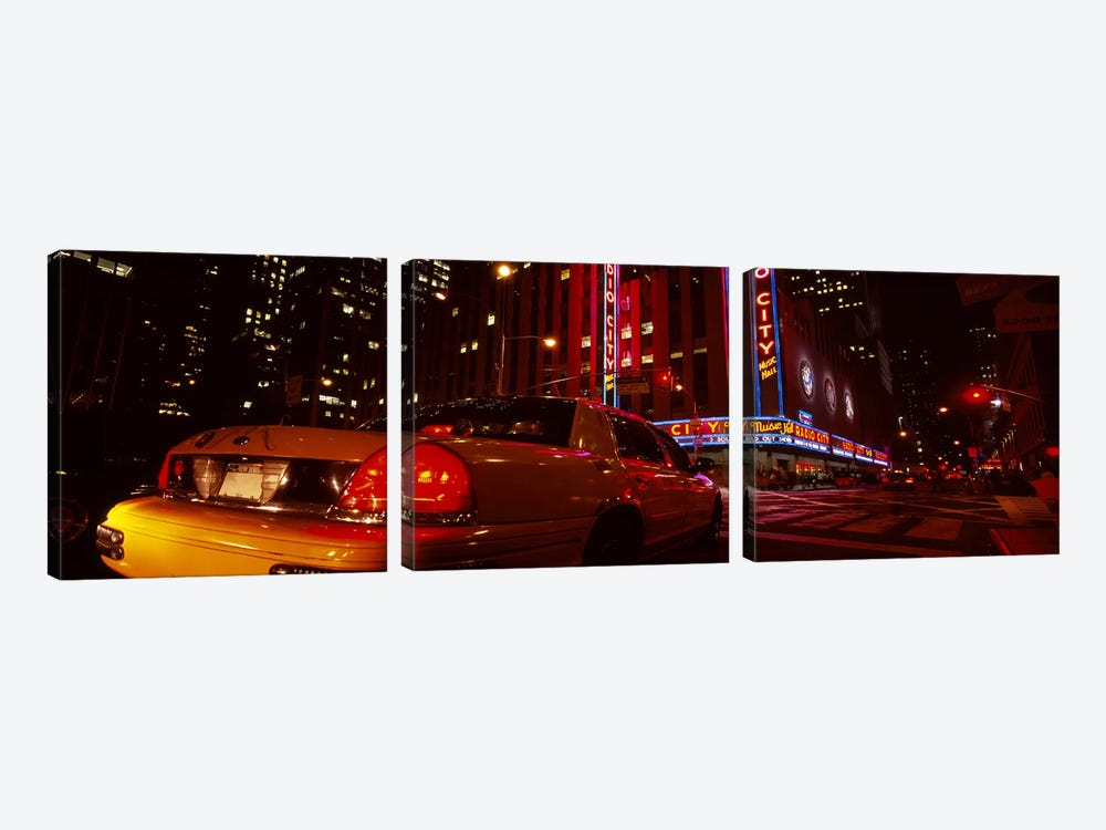 Car on a road, Radio City Music Hall, Rockefeller Center, Manhattan, New York City, New York State, USA by Panoramic Images 3-piece Canvas Print