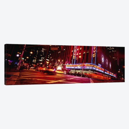 Bluirred Motion View Of Traffic Around Radio City Music Hall, Rockefeller Center, Manhattan, New York City, New York, USA Canvas Print #PIM5456} by Panoramic Images Canvas Artwork
