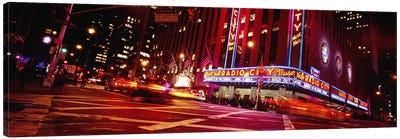 Low angle view of buildings lit up at night, Radio City Music Hall, Rockefeller Center, Manhattan, New York City, New York State Canvas Art Print