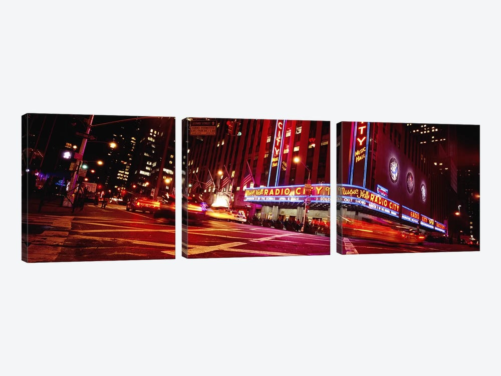 Bluirred Motion View Of Traffic Around Radio City Music Hall, Rockefeller Center, Manhattan, New York City, New York, USA by Panoramic Images 3-piece Canvas Artwork