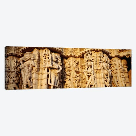 Sculptures carved on a wall of a temple, Jain Temple, Ranakpur, Rajasthan, India Canvas Print #PIM5468} by Panoramic Images Canvas Art