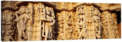 Sculptures carved on a wall of a temple, Jain Temple, Ranakpur, Rajasthan, India Canvas Print #PIM5468