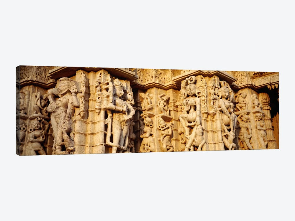 Sculptures carved on a wall of a temple, Jain Temple, Ranakpur, Rajasthan, India by Panoramic Images 1-piece Art Print