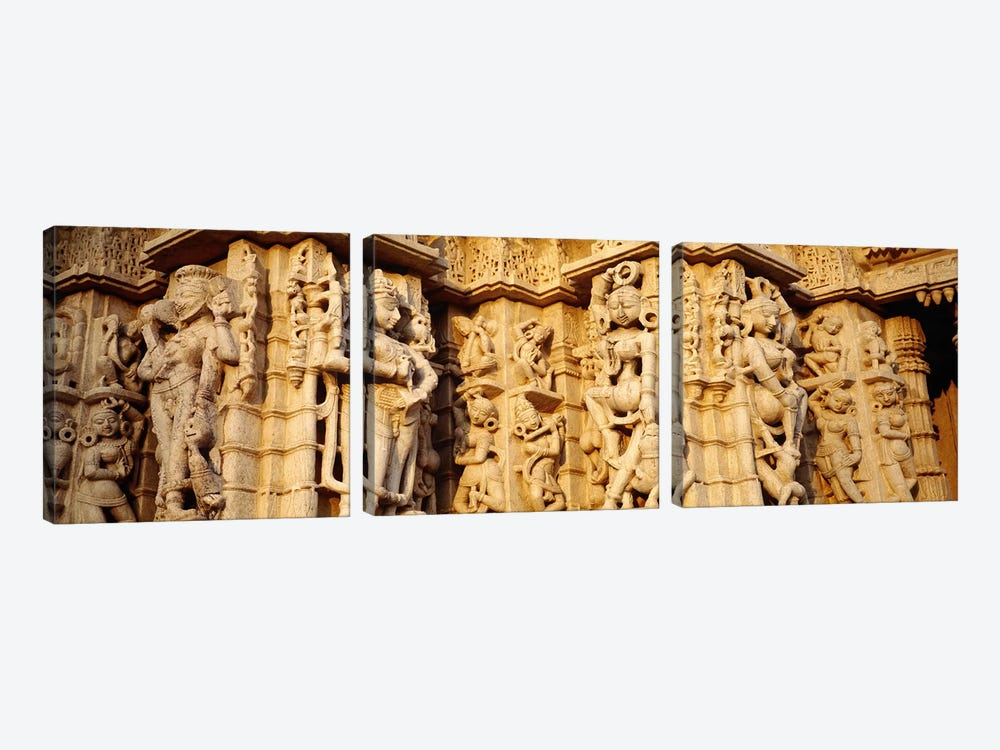 Sculptures carved on a wall of a temple, Jain Temple, Ranakpur, Rajasthan, India by Panoramic Images 3-piece Canvas Art Print