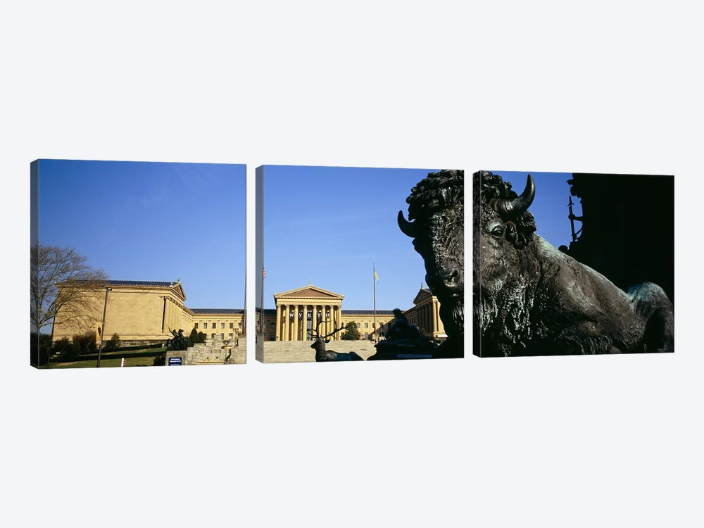 Close-up of a sculpture of a buffalo with a museum in the background, Philadelphia Museum Of Art, Philadelphia, Pennsylvania, US by Panoramic Images 3-piece Canvas Art Print