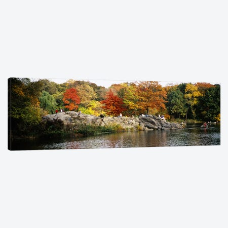 Group of people sitting on rocks, Central Park, Manhattan, New York City, New York, USA Canvas Print #PIM5594} by Panoramic Images Canvas Print