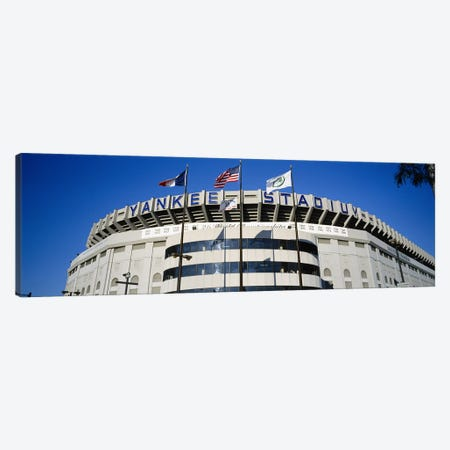 Flags in front of a stadium, Yankee Stadium, New York City, New York, USA Canvas Print #PIM5599} by Panoramic Images Canvas Wall Art