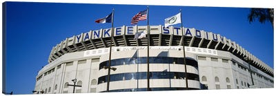 Flags in front of a stadium, Yankee Stadium, New York City, New York, USA Canvas Art Print