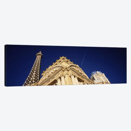 Low angle view of a building in front of a replica of the Eiffel Tower, Paris Hotel, Las Vegas, Nevada, USA Canvas Print #PIM5604} by Panoramic Images Art Print