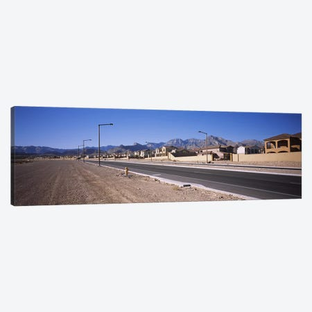 Houses in a row along a road, Las Vegas, Nevada, USA Canvas Print #PIM5606} by Panoramic Images Canvas Print