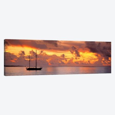 Boat at sunset  Canvas Print #PIM562} by Panoramic Images Art Print