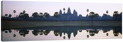 Reflection of temples and palm trees in a lake, Angkor Wat, Cambodia Canvas Art Print