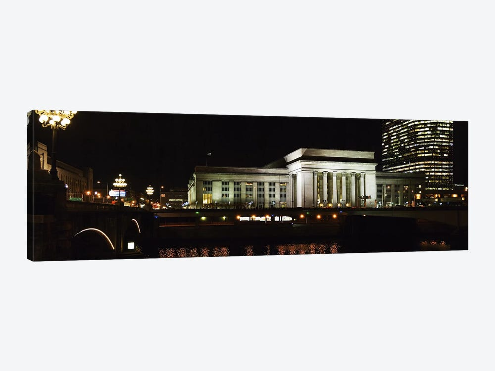 Buildings lit up at night at a railroad station, 30th Street Station, Schuylkill River, Philadelphia, Pennsylvania, USA by Panoramic Images 1-piece Canvas Print