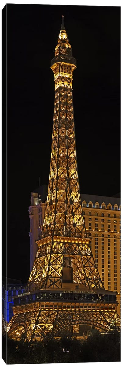 Replica of the Eiffel Tower lit up at night, Paris Las Vegas, Las Vegas, Nevada, USA Canvas Art Print
