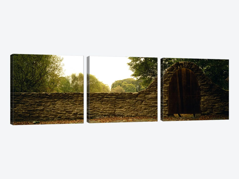 Wooden Door In An Arch Along A Stone Wall, County Kilkenny, Leinster Province, Republic Of Ireland by Panoramic Images 3-piece Canvas Print