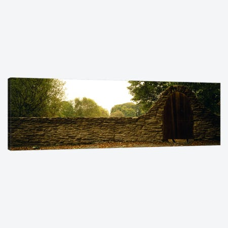Wooden Door In An Arch Along A Stone Wall, County Kilkenny, Leinster Province, Republic Of Ireland Canvas Print #PIM5706} by Panoramic Images Canvas Wall Art