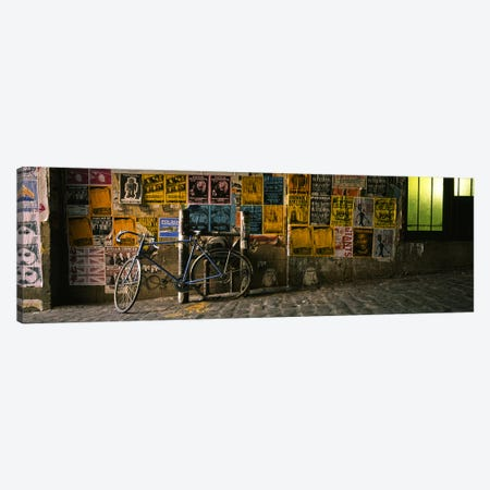 Bicycle leaning against a wall with posters in an alley, Post Alley, Seattle, Washington State, USA Canvas Print #PIM5710} by Panoramic Images Canvas Art