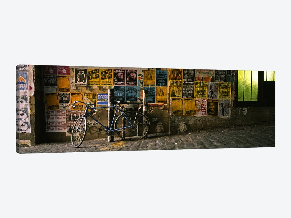 Bicycle leaning against a wall with posters in an alley, Post Alley, Seattle, Washington State, USA by Panoramic Images 1-piece Canvas Art