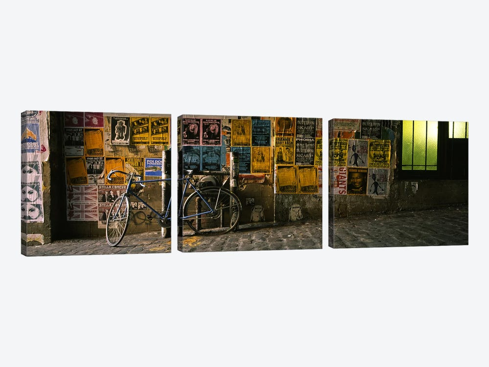 Bicycle leaning against a wall with posters in an alley, Post Alley, Seattle, Washington State, USA by Panoramic Images 3-piece Canvas Wall Art