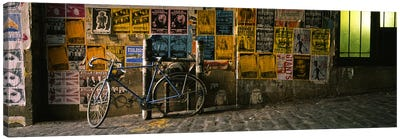 Bicycle leaning against a wall with posters in an alley, Post Alley, Seattle, Washington State, USA Canvas Art Print