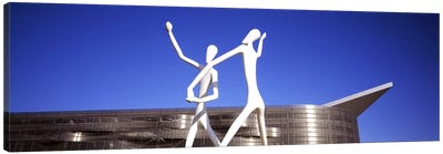 Dancers sculpture by Jonathan Borofsky in front of a building, Colorado Convention Center, Denver, Colorado, USA Canvas Art Print