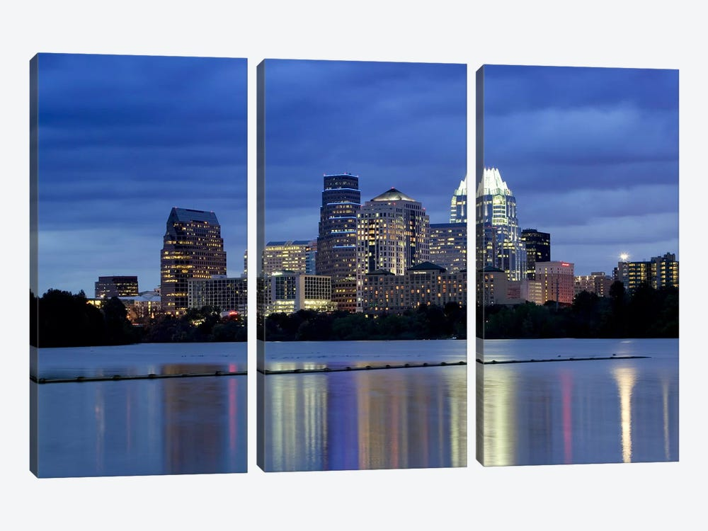 Buildings at the waterfront lit up at dusk, Town Lake, Austin, Texas, USA by Panoramic Images 3-piece Canvas Print