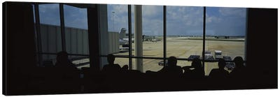 Silhouette of a group of people at an airport lounge, Orlando International Airport, Orlando, Florida, USA Canvas Art Print