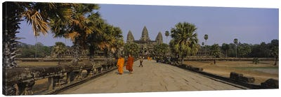Two monks walking in front of an old temple, Angkor Wat, Siem Reap, Cambodia Canvas Art Print