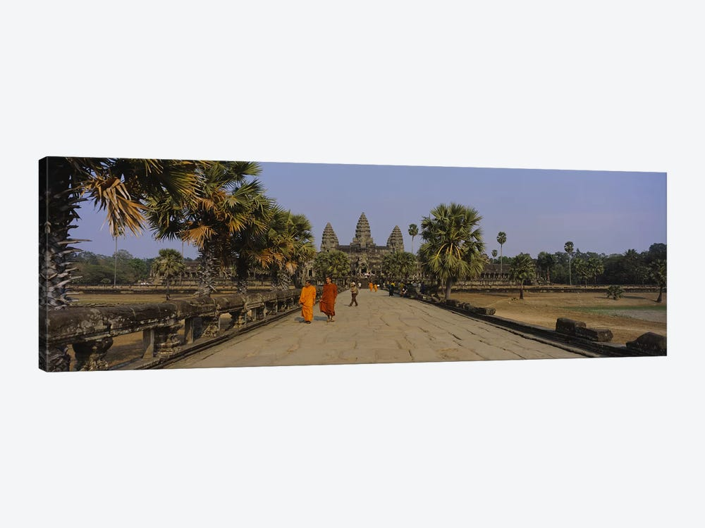 Two monks walking in front of an old temple, Angkor Wat, Siem Reap, Cambodia by Panoramic Images 1-piece Art Print
