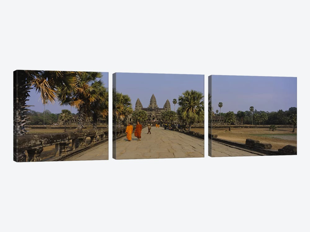 Two monks walking in front of an old temple, Angkor Wat, Siem Reap, Cambodia by Panoramic Images 3-piece Canvas Print