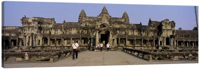 Tourists walking in front of an old temple, Angkor Wat, Siem Reap, Cambodia Canvas Art Print
