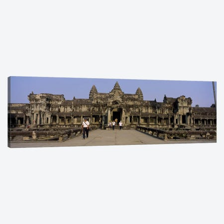 Tourists walking in front of an old temple, Angkor Wat, Siem Reap, Cambodia Canvas Print #PIM5885} by Panoramic Images Canvas Art Print