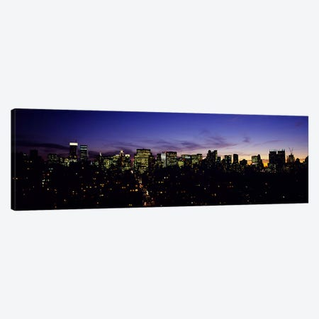 Skyscrapers in a city lit up at night, Manhattan, New York City, New York State, USA Canvas Print #PIM5896} by Panoramic Images Canvas Wall Art