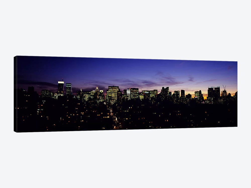 Skyscrapers in a city lit up at night, Manhattan, New York City, New York State, USA by Panoramic Images 1-piece Canvas Artwork