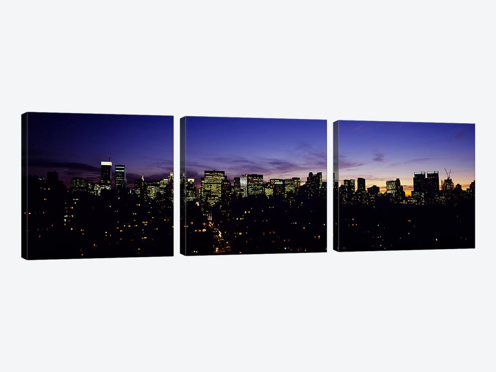 Skyscrapers in a city lit up at night, Manhattan, New York City, New York State, USA by Panoramic Images 3-piece Canvas Wall Art