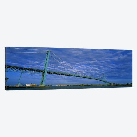 Low angle view of a suspension bridge over the river, Ambassador Bridge, Detroit River, Detroit, Michigan, USA Canvas Print #PIM5938} by Panoramic Images Canvas Artwork