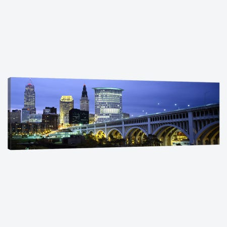 Bridge in a city lit up at dusk, Detroit Avenue Bridge, Cleveland, Ohio, USA Canvas Print #PIM5966} by Panoramic Images Canvas Art