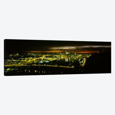 High angle view of buildings lit up at dawnPittsburgh, Pennsylvania, USA Canvas Print #PIM5969} by Panoramic Images Canvas Print