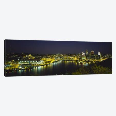 High angle view of buildings lit up at nightThree Rivers Area, Pittsburgh, Pennsylvania, USA Canvas Print #PIM5973} by Panoramic Images Canvas Wall Art