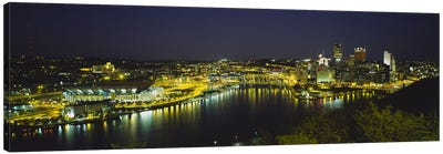 High angle view of buildings lit up at nightThree Rivers Area, Pittsburgh, Pennsylvania, USA Canvas Art Print
