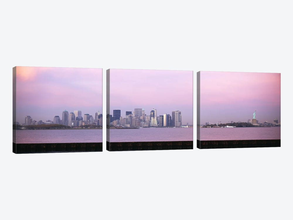 Skyscrapers & a statue at the waterfront, Statue of Liberty, Manhattan, New York City, New York State, USA by Panoramic Images 3-piece Canvas Artwork