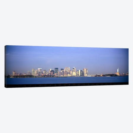 Skyscrapers & a statue at the waterfront, Statue of Liberty, Manhattan, New York City, New York State, USA Canvas Print #PIM6078} by Panoramic Images Canvas Art Print