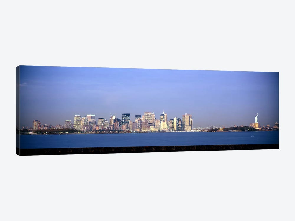 Skyscrapers & a statue at the waterfront, Statue of Liberty, Manhattan, New York City, New York State, USA by Panoramic Images 1-piece Art Print