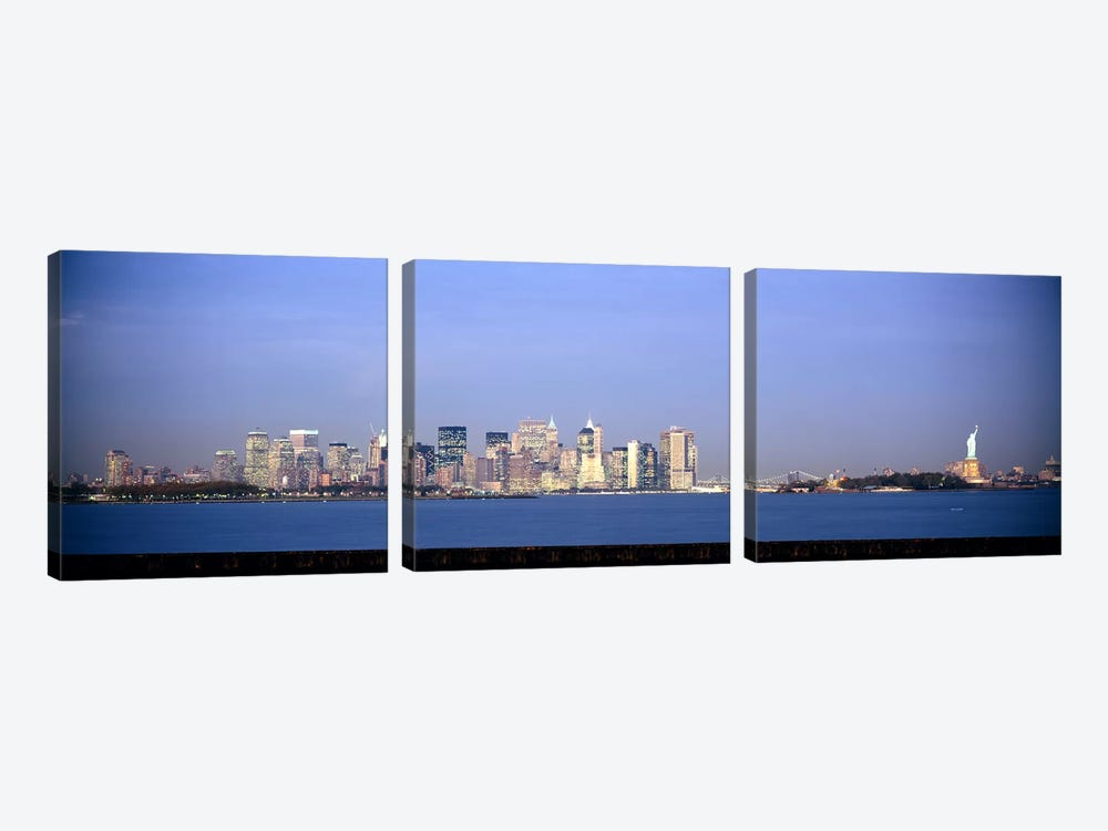 Skyscrapers & a statue at the waterfront, Statue of Liberty, Manhattan, New York City, New York State, USA by Panoramic Images 3-piece Art Print
