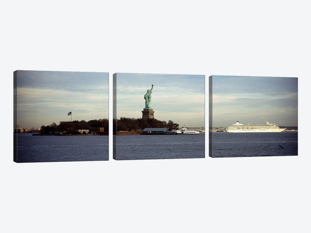 Statue on an island in the seaStatue of Liberty, Liberty Island, New York City, New York State, USA by Panoramic Images 3-piece Canvas Wall Art