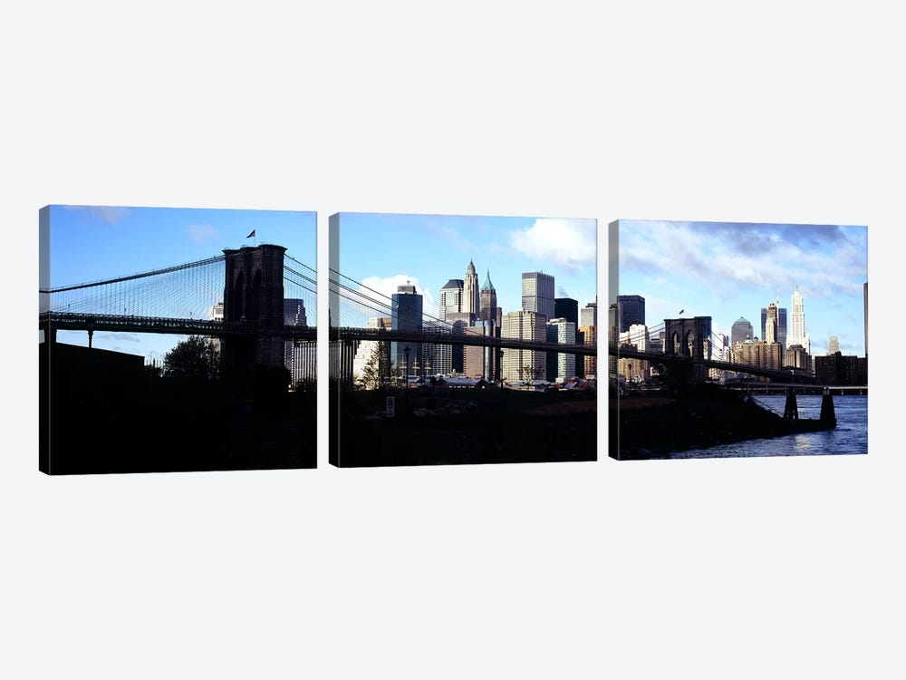 Skyscrapers at the waterfront, Brooklyn Bridge, East River, Manhattan, New York City, New York State, USA by Panoramic Images 3-piece Canvas Print