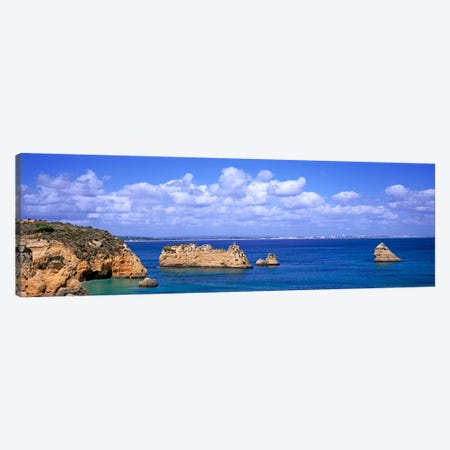 Cloudy Seascape With Limestone Outcrops, Dona Ana Beach, Lagos, Algarve Region, Portugal Canvas Print #PIM609} by Panoramic Images Canvas Artwork