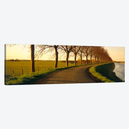 Tree-Lined Riverside Road, Noordbeemster, North Holland, Netherlands Canvas Print #PIM610} by Panoramic Images Canvas Print