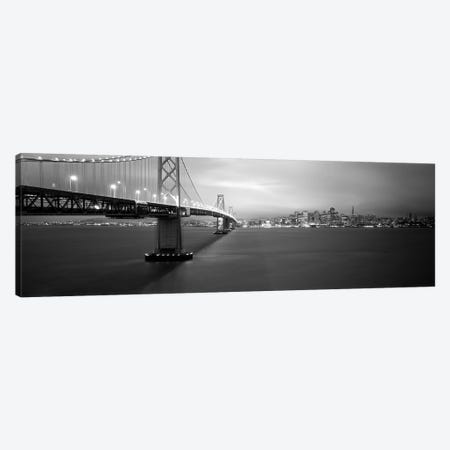 Low angle view of a suspension bridge lit up at nightBay Bridge, San Francisco, California, USA Canvas Print #PIM6281} by Panoramic Images Canvas Wall Art